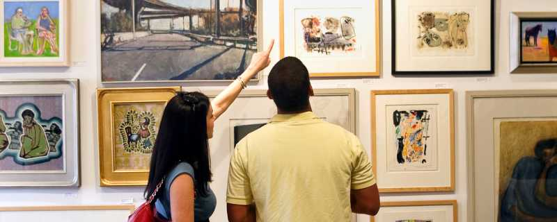 Couple looking at art on a wall
