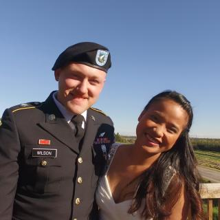 a USAF airman in uniform with his spouse