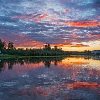 A sign that reads LOVE ALASKA during a sunset along the Chena River
