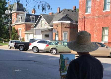 Artist painting the Hendricks County Historical Museum (Photo courtesy of the Gallery on the Square Facebook page)