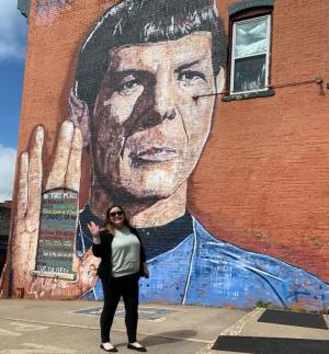 A woman in front of the Spock Mural at Gator Game & Hobby in Leavenworth