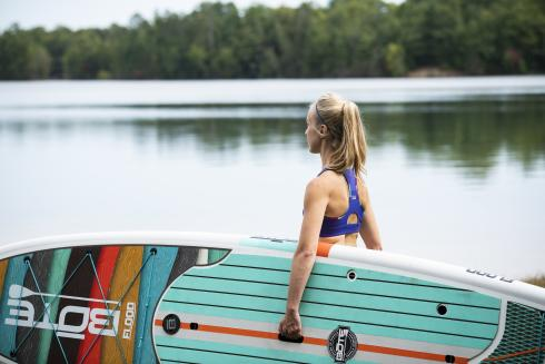 Woman holding a paddleboard