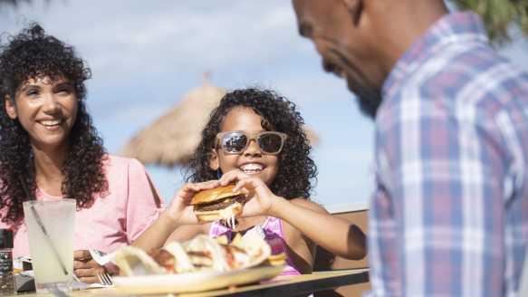 A family enjoys a meal outside in Daytona Beach