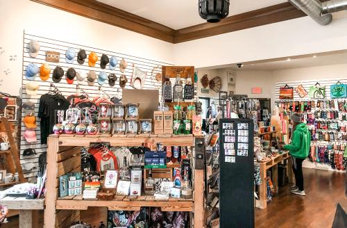 Inside the store of Regalo with hats and other store goods