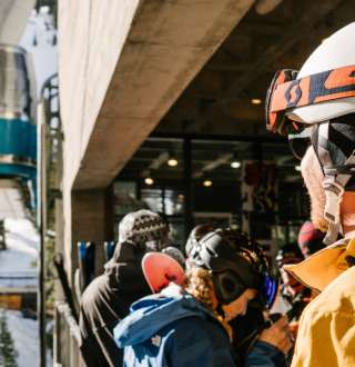 Skiers waiting for Snowbird's Aerial Tram to Hidden Peak