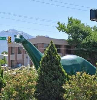Sinclair Gas Dinosaur peeking through the trees