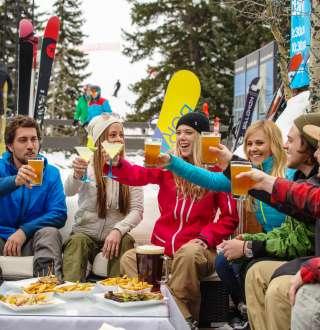 Friends Drinking at Snowbird Tram Deck after Skiing