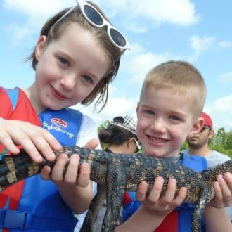 Family Fun - Cajun Encounters - kids with alligator