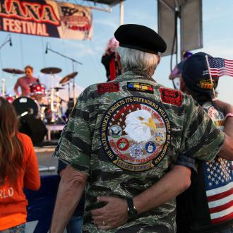 Military Veteran, Couple at Festival