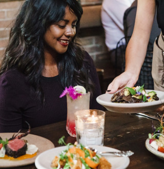 A group of friends enjoying a meal at a Downtown Salt Lake City Restaurant