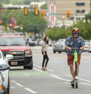 Man Riding Lime Scooter Downtown