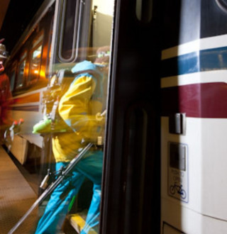 Skiers boarding a Utah Transit Authority TRAX car