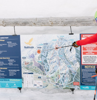Consulting the ski map at Solitude Mountain Resort