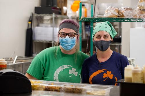 oTwo women wearing facemasks at Orange Clover Kitchen in Southern Indiana