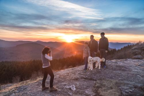 Hikers getting photographed in the sunset