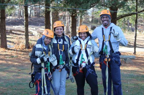 Family enjoying the fun at the Adventure Center of Asheville