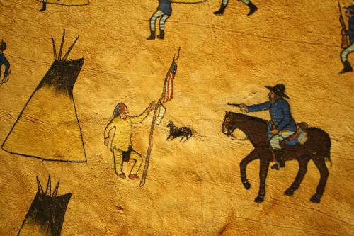 Hide Painting by Stone Rabbit, depicting the the US Army attacking a peaceful Chief Black Kettle at the Sand Creek Massacre near Eads, Colorado. Original Art on display at the Buffalo Bill Center in Cody, Wyoming.
