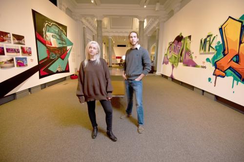 Couple Standing in Carnegie Center for Art & History graffiti exhibit.