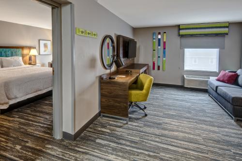 A view of a room and living room suite at the New Albany Best Western.