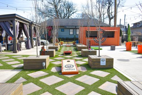 Outdoor space with tables and games at the Union GameYard in Jeffersonville, IN