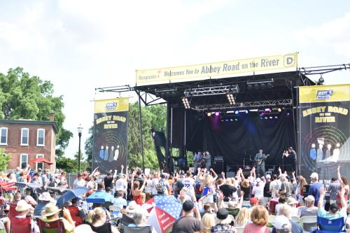 Crowds enjoy an outdoor concert at Abbey Road on the River in Jeffersonville, IN