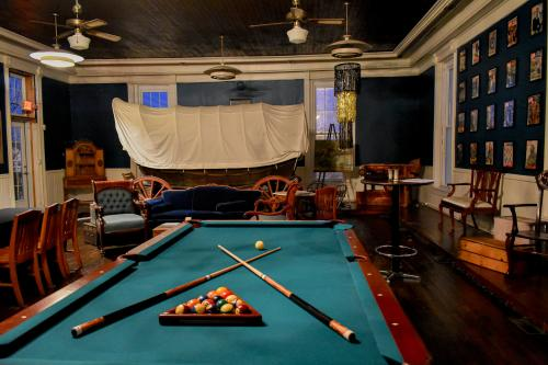 Pool table with balls and sticks at the 1894 Lodge in New Washington, IN