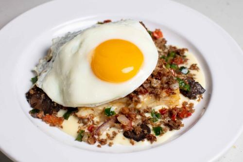 Scramble topped with a sunny side up egg from Wild Eggs