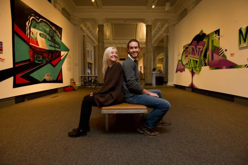 Couple sitting back-to-back at the Carnegie Center Graffiti