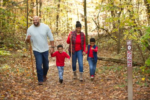 Couple with children hiking Knobstone Trail in Deam Lake