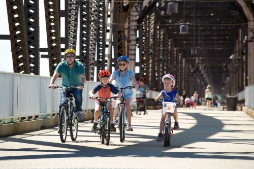 Family biking on the Big Four Bridge