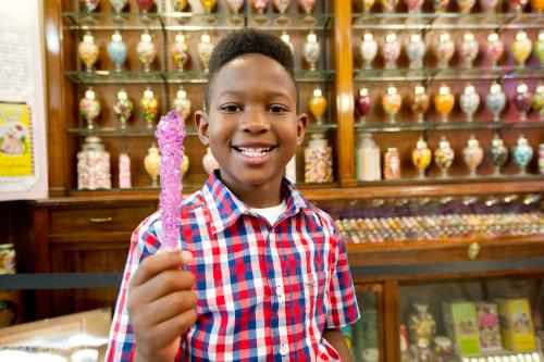 Boy holding candy at Schimpff's Confectionery