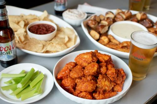 Bufalo Wings & Rings assortment of wings, appetizers and beer.