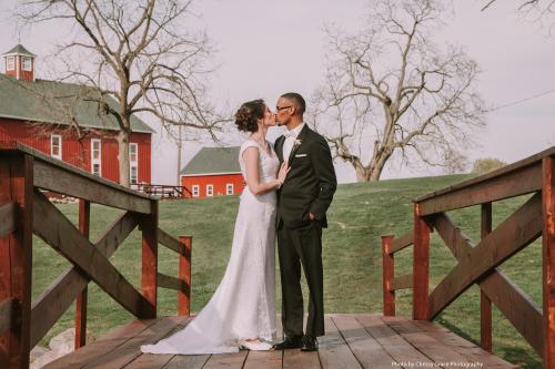 Married Couple Kissing on Avon Wedding Barn Bridge
