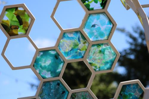 Close up of blue and green glass sculpture