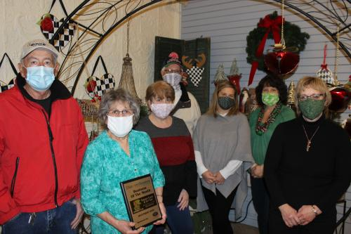 Owner and staff of Sinicropi Florist pose for a group photo for being honored with the December Business of the Month Award