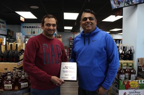 Staff from 5&20 Wine & Spirits posing with the March 2021 Business of the Month Plaque