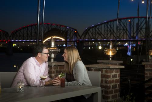 Couple dining outside at the Portage House for date night
