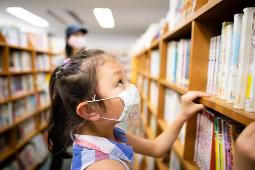 Child in Library with Mask