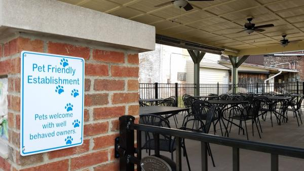 Enjoy the outdoor seating on the patio at Gather Around BBQ - pups are welcome, too!