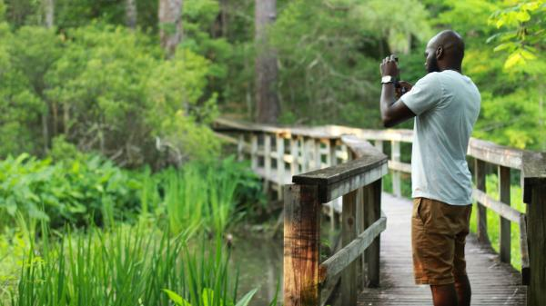 Man Birding at Northlake Nature Center in Mandeville, at the edge of Big Branch NWR
