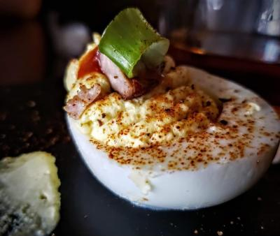 Luther's BBQ Deviled Egg with a green onion garnish