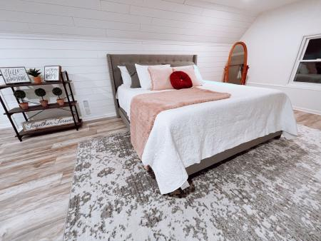 Bedroom inside the wedding cottage and bridal suite at Avon Wedding Barn