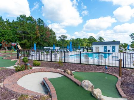 Raleigh Oaks RV Park putt-putt course and pool, located in Four Oaks, NC.
