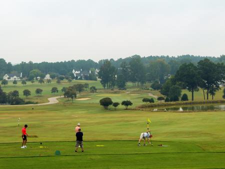 Riverwood Golf Course group of men on the green in Clayton, NC.