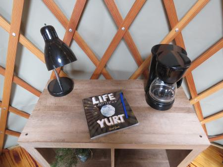 photo of a guestbook and coffee maker at a yurt in Alexandria ky at aj jolly park