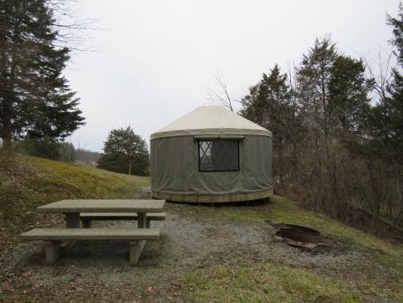 photo of a yurt, fire pit, and picnic table at aj jolly park in Alexandria ky