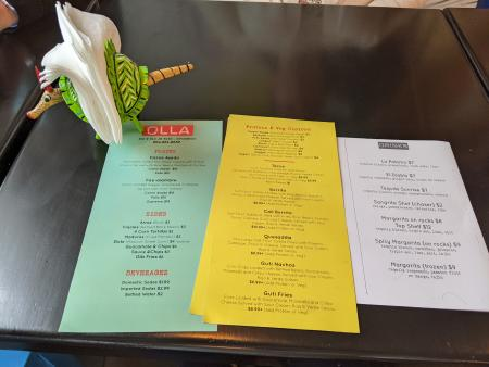 printed menus displayed on the table at olla in covington ky