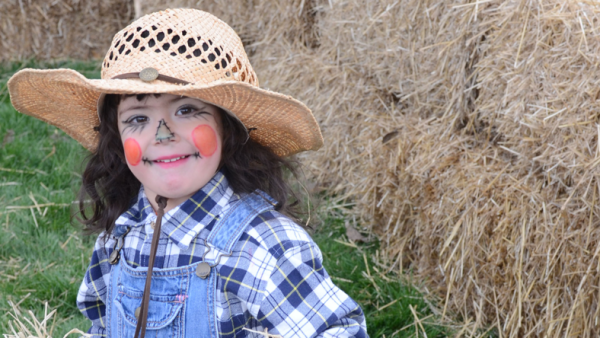 Girl dressed as scarecrow.