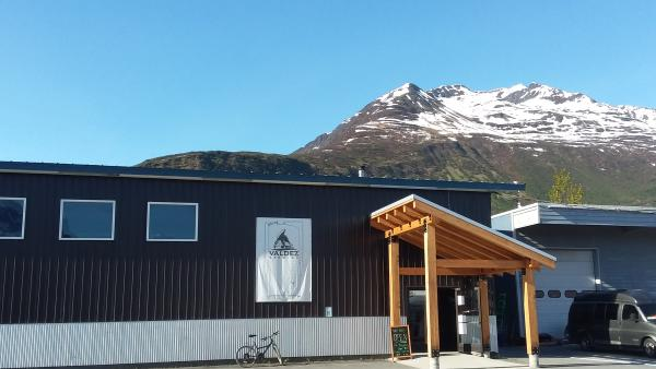 a brewery next to a mountain