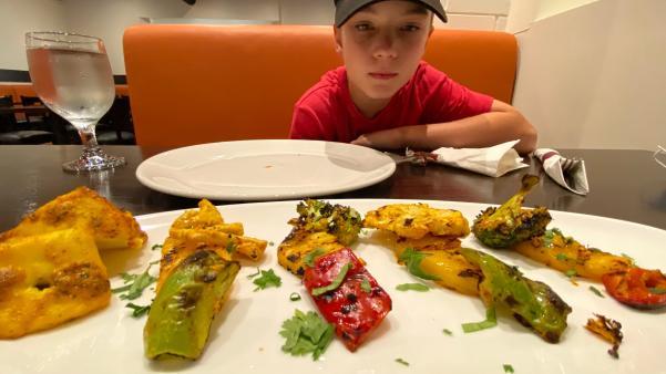 A boy eating dinner at a restaurant
